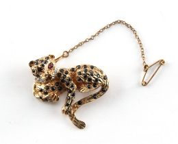 A 9ct gold multi gem set leopard brooch, with ruby eyes, sapphire spots & diamond collar, with