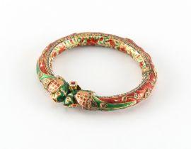 An Indian high carat gold (tests circa 22ct) enamel & diamond hinged bangle (kara), probably Jaipur,