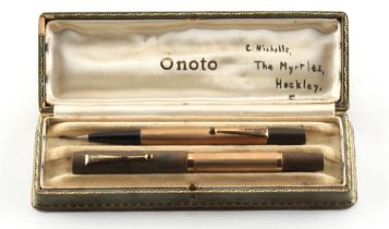 An Onoto fountain pen with 9ct gold barrel, nib missing, London 1934; together with a similar