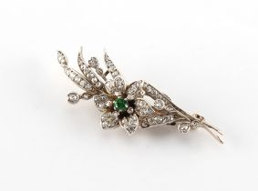 A Victorian emerald & diamond floral spray brooch, 59mm long.