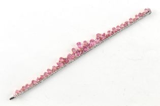William & Son, London - a very attractive pink sapphire & diamond fringe bracelet, the total pink