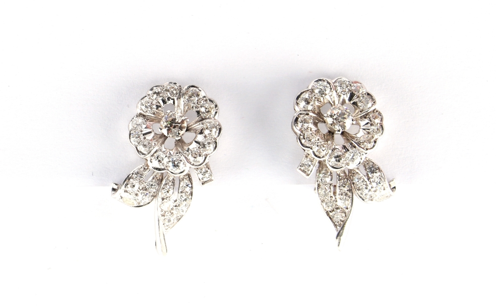 A pair of white gold diamond floral earrings, with clip fastenings, the estimated total diamond - Image 2 of 2