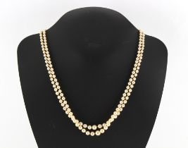 A pearl two strand necklace, the largest pearl approximately 7mm diameter, with silver & marcasite