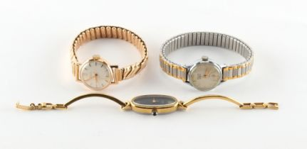 A lady's Doxa 14ct gold cased wristwatch on elasticated link strap, the links each marked 585 with