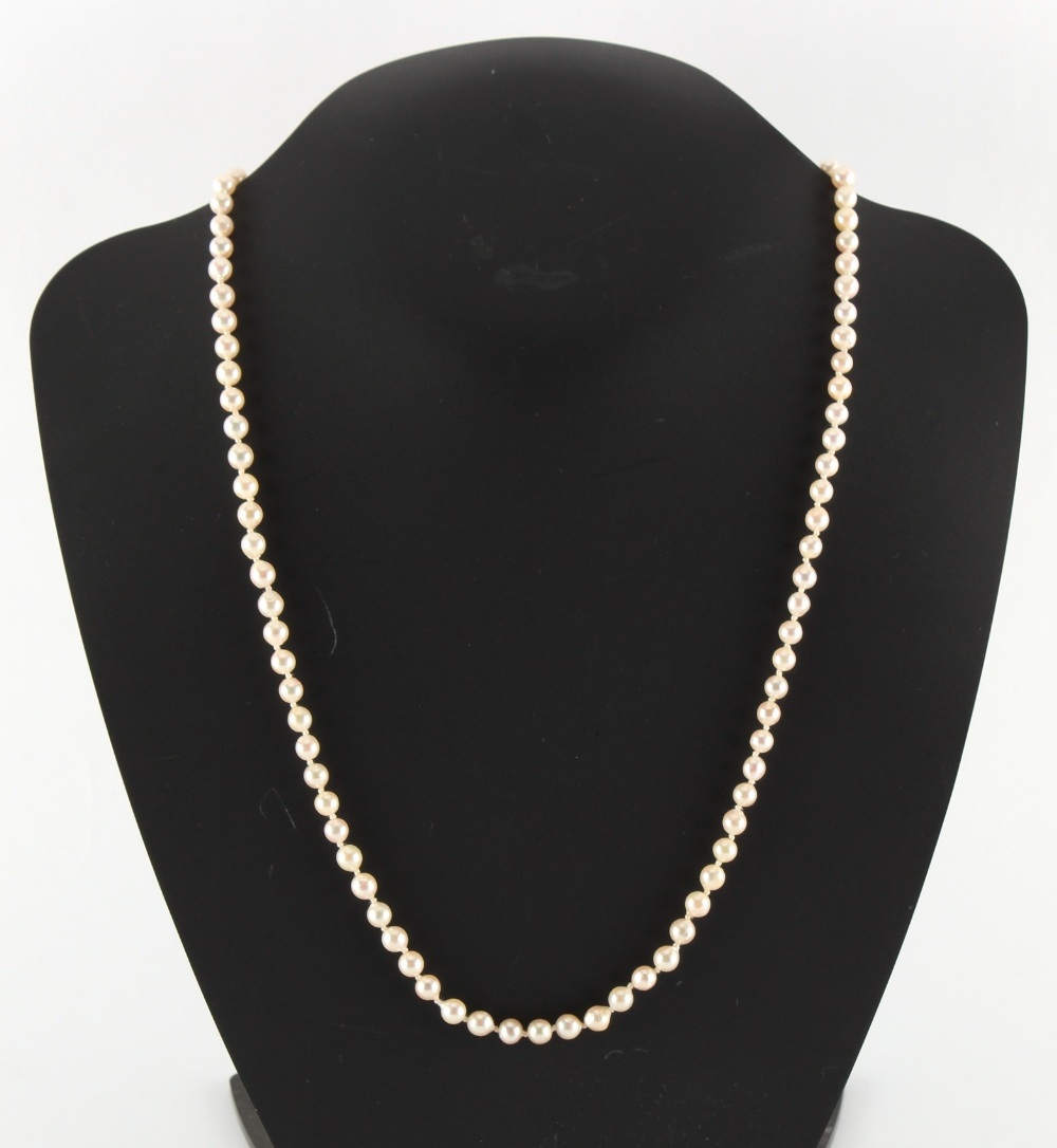 A cultured pearl single strand necklace, the uniform beads approximately 5mm diameter, with 9ct gold