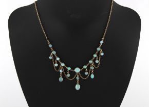 An attractive yellow gold opal festoon necklace, 16.5ins. (42cms.) long.