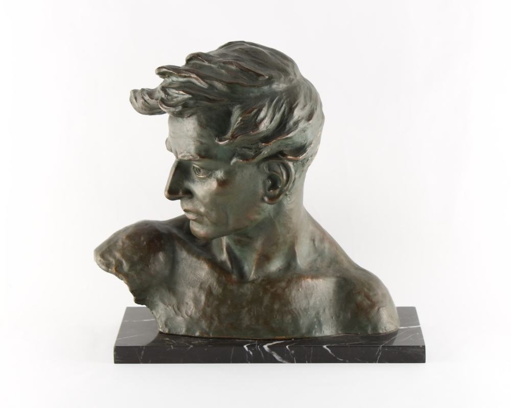 Johannes Dommisse (Austrian, 1878-1955) - a bronze coloured terracotta bust of a young man, on