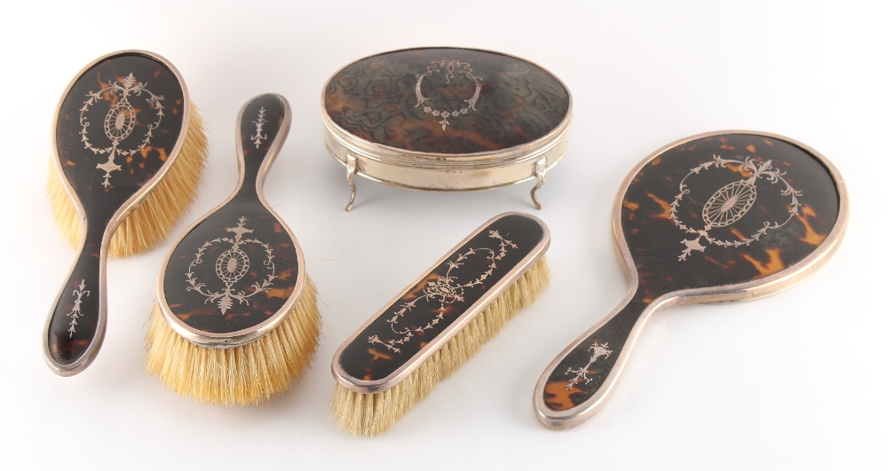 An early 20th century silver & tortoiseshell pique work oval dressing table jewellery box,