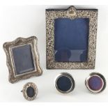 Five silver photograph frames, the largest 11.8ins. (30cms.) high (5).