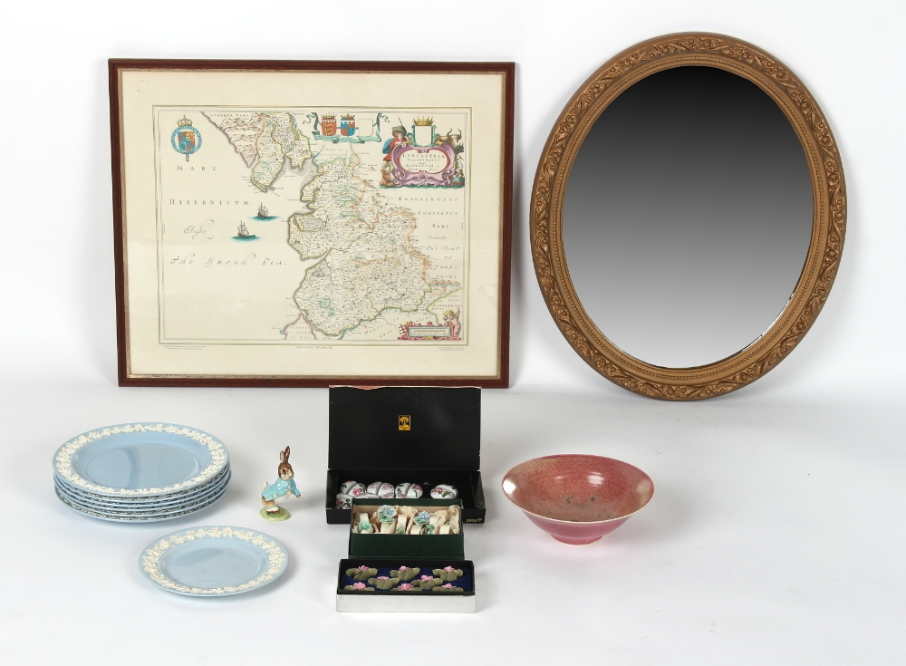 A gilt painted oval framed wall mirror; together with a framed map print; and a box containing