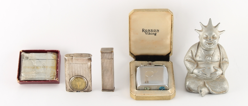 Five assorted lighters including a Swiss silver lighter with Eterna watch, the winder missing, an