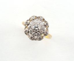 An 18ct yellow gold diamond cluster ring, with pierced millegrain setting, the centre stone