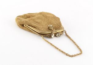 A mesh evening bag, circa 1945-52, with label 'MADE IN US ZONE GERMANY'.