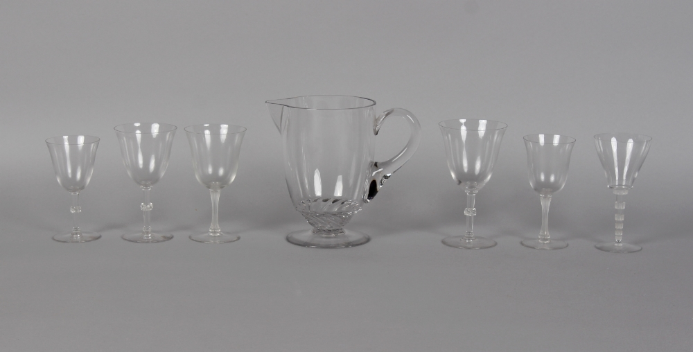Three Lalique Beaugency drinking glasses, the tallest 6.3ins. (16cms.) high; together with two