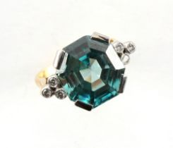 An 18ct yellow gold zircon & diamond ring, the large octagonal cut zircon measuring approximately 14