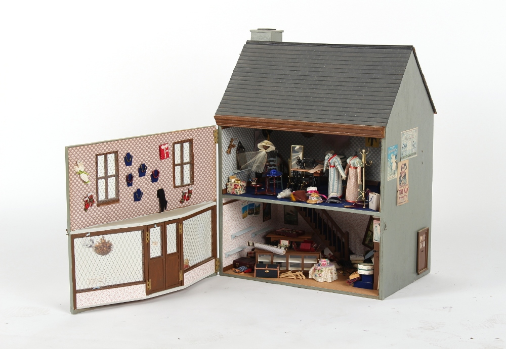 A doll's house entitled 'Hartman Toys Fabric', with furniture & furnishings, 19ins. (48cms.) long. - Image 2 of 2