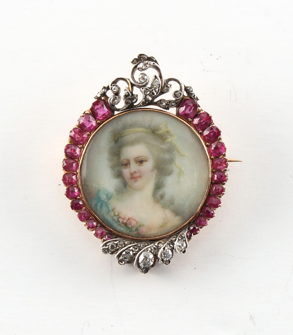 A good 19th century ruby & diamond brooch centred by a portrait miniature of a young lady in blue