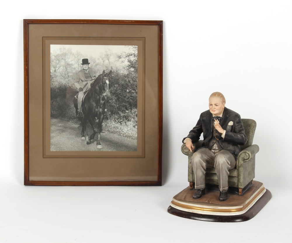A Capodimonte figure of Winston Churchill, by Bruno Merli, 11.4ins. (29cms.) high; together with a
