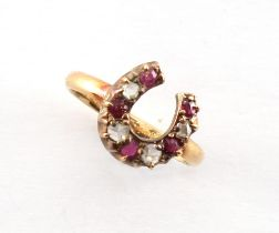 A Victorian 18ct gold ruby & diamond horseshoe ring, size J, boxed.