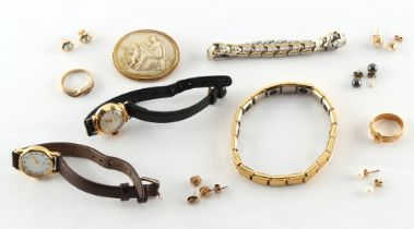 A bag containing assorted jewellery including an Edwardian 18ct gold buckle ring, approximately 3.