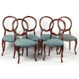 A set of six Victorian style mahogany balloon back dining chairs, with pale blue upholstery &