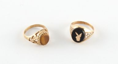A 9ct gold Bunny signet ring, size L/M; together with a 9ct gold tiger's eye ring, size I/J (2).