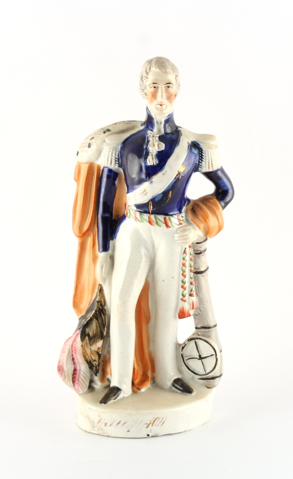 A Victorian Staffordshire figure of the Duke of Wellington, titled to the base. 10.3ins. (26.