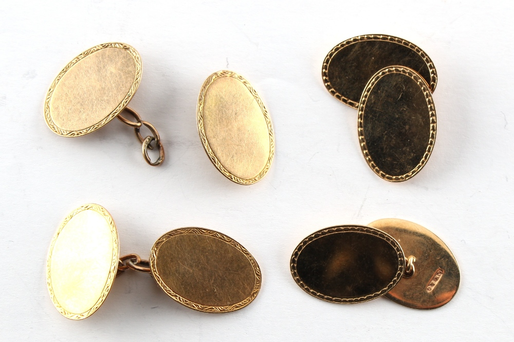 Two pairs of 9ct gold oval panelled cufflinks, one panel detached, approximately 9.1 grams total (