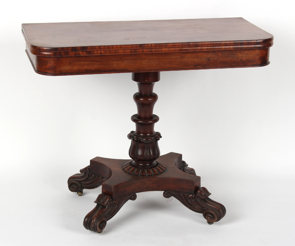 A William IV mahogany fold-over tea table, circa 1835, with carved tulip decorated column &