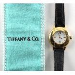 Tiffany & Co. - a lady's 18ct gold cased wristwatch, on black leather strap with 18ct gold buckle,