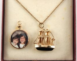 A 9ct gold & black onyx galleon pendant, 27mm high, on gold plated chain necklace, boxed; together