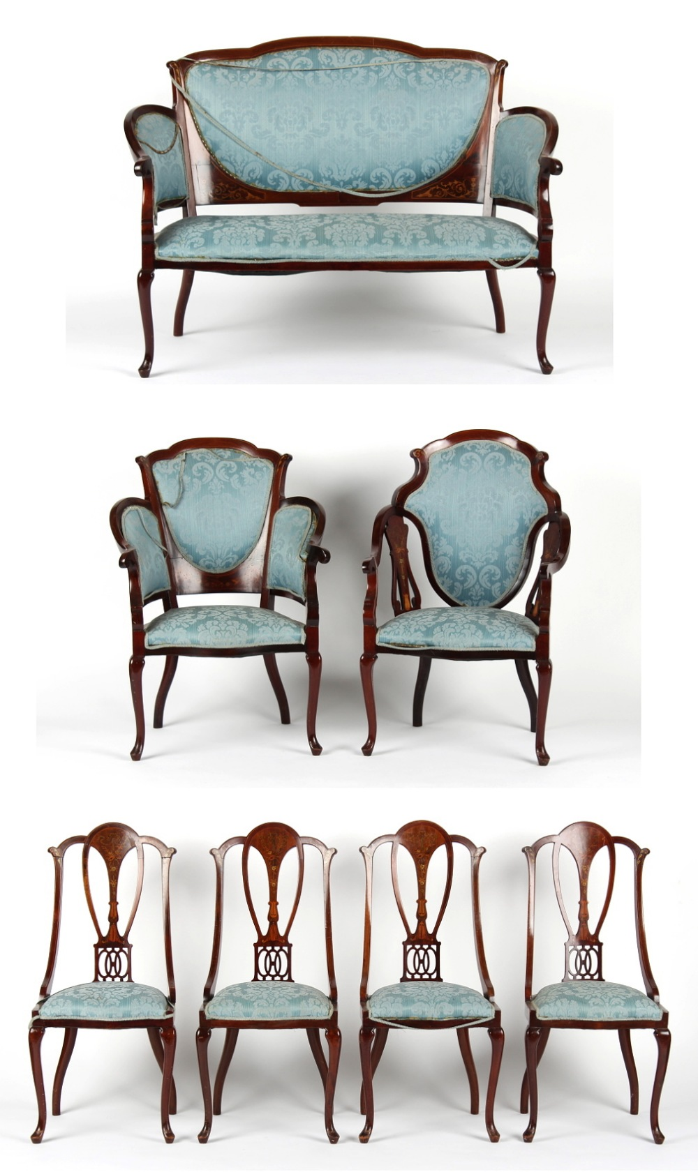 An Edwardian mahogany & marquetry inlaid seven piece salon suite, with patterned blue upholstery (