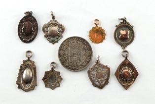 Eight late 1920's / early 1930's medals, comprising one 9ct gold example (approximately 2.4