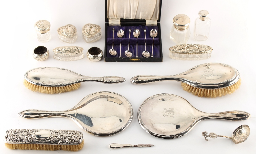 A box containing assorted silver & silver mounted items including a cased set of six seal top coffee