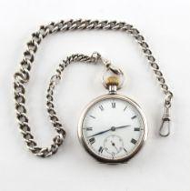 A silver cased keyless wind pocket watch on silver watch chain.