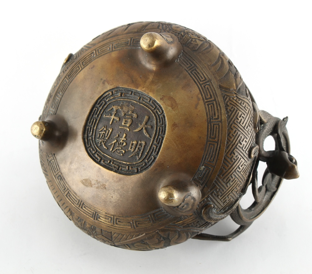 A Chinese ornate bronze censer, the pierced cover with dragon finial, 8.7ins. (22cms.) across ( - Image 3 of 3