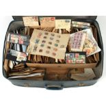Stamps - World: A large suitcase with stamps sorted into envelopes and loose. (Viewing recommended).