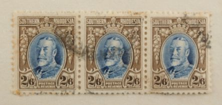 Stamps - World: A mixed lot in a carton including Southern Rhodesia 1931-37 2/6d. strip of three