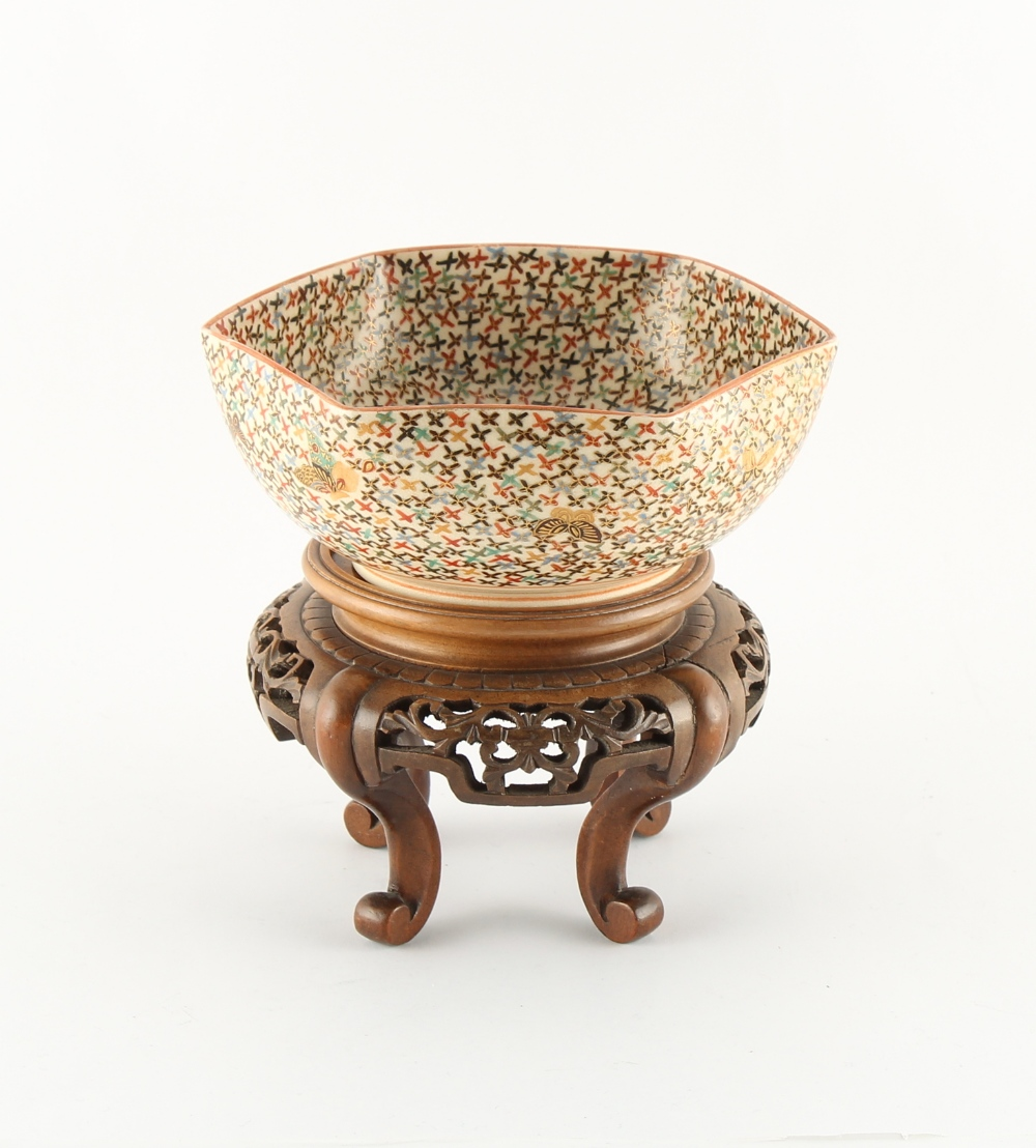 A Japanese Satsuma hexagonal bowl, decorated with butterflies on a multi-coloured cross ground,