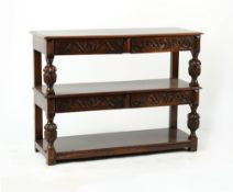 Property of a deceased estate - a good quality 17th century style carved oak three tier buffet,