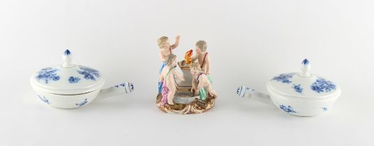 Property of a deceased estate - a small Meissen group of four putti gathered around a fire on a