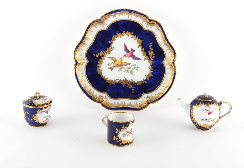 Property of a gentleman - a 19th century Sevres style cabaret set, painted with exotic birds on a
