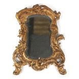 Property of a lady - a 19th century carved giltwood framed wall mirror with shaped & bevelled plate,