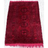 Property of a lady - an Afghan rug, 83 by 55ins. (211 by 140cms.).