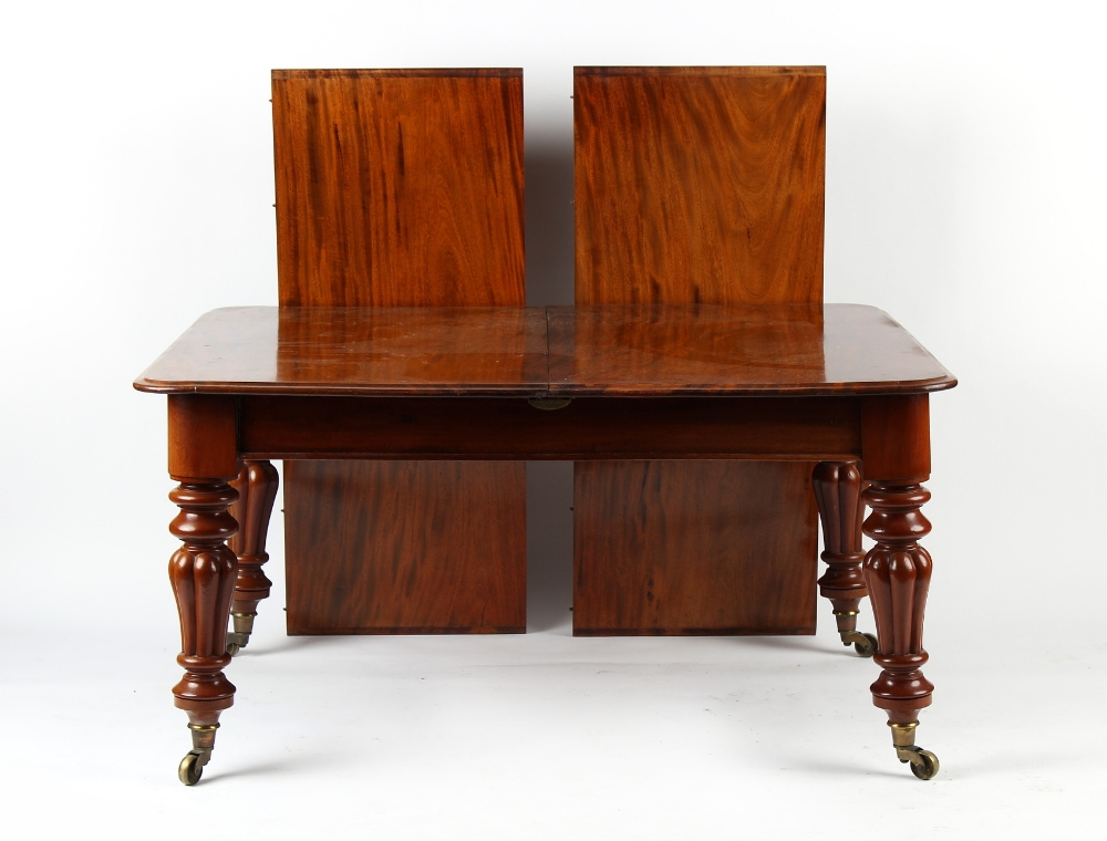 Property of a lady - a Victorian mahogany telescopic wind-out extending dining table with two