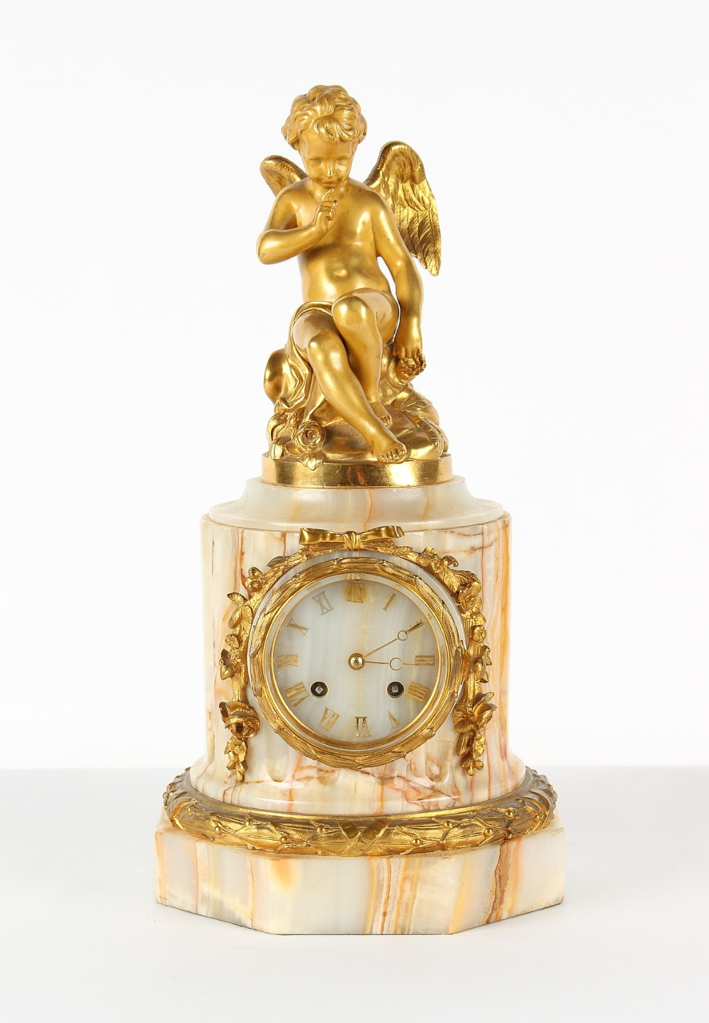 Property of a lady - a late 19th century French ormolu mounted onyx mantel clock, surmounted by a