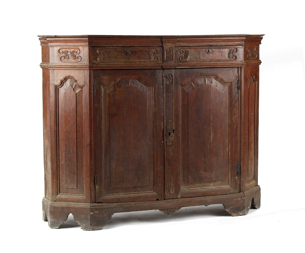 Property of a gentleman - an 18th century Flemish carved oak side cabinet with two drawers above two