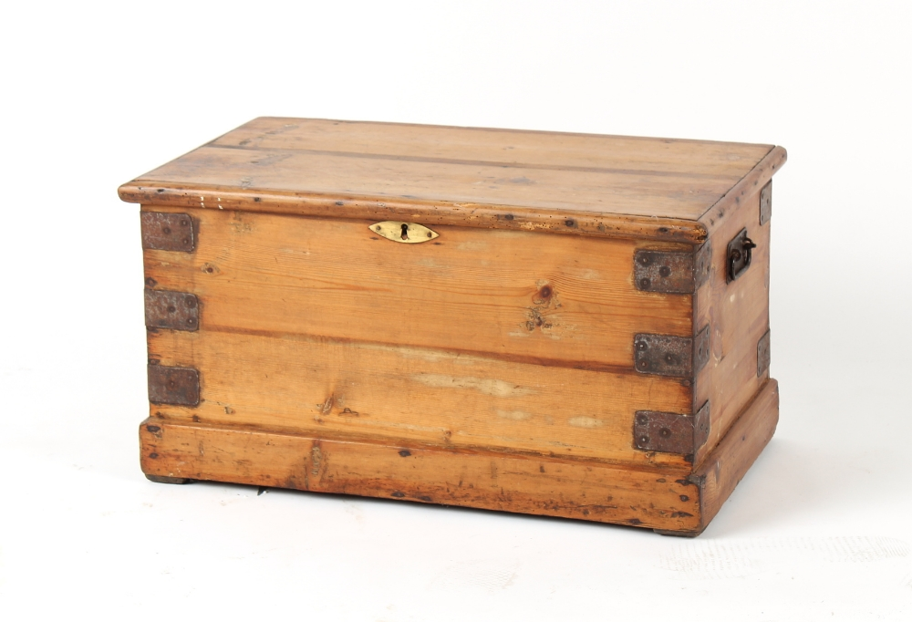 Property of a lady - a pine & metal bound trunk, 26.6ins. (67.5cms.) long.