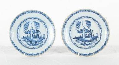 Property of a gentleman - a pair of mid 18th century Delft blue & white shallow dishes, with painted