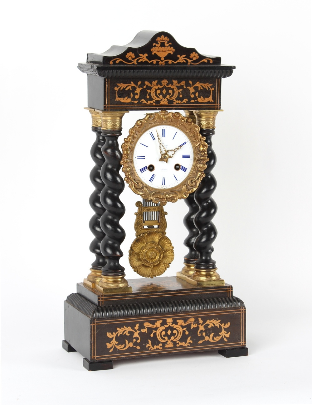 Property of a deceased estate - a mid 19th century French gilt metal mounted ebonised portico clock,